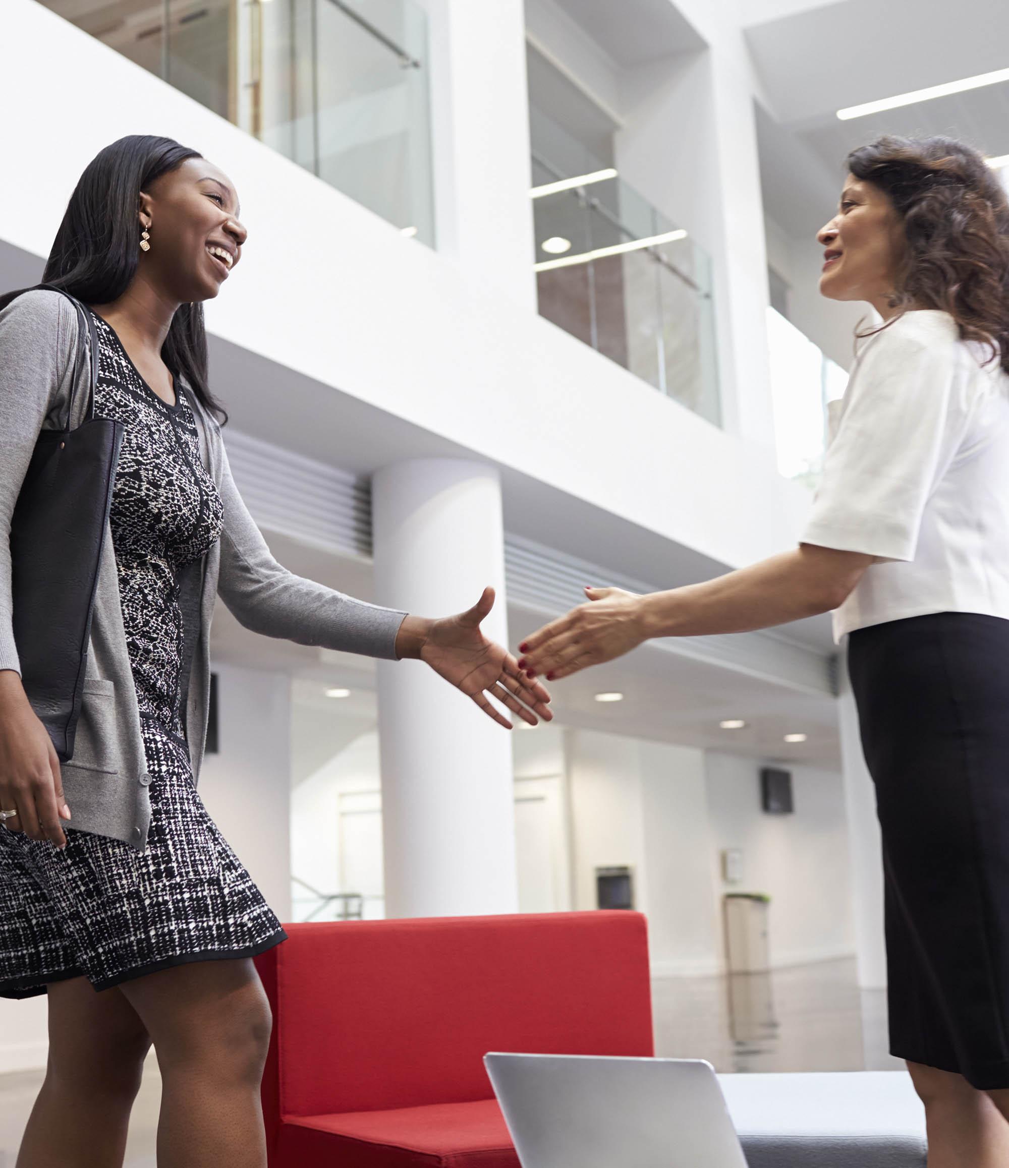 WOmen Business Handshake Lobby